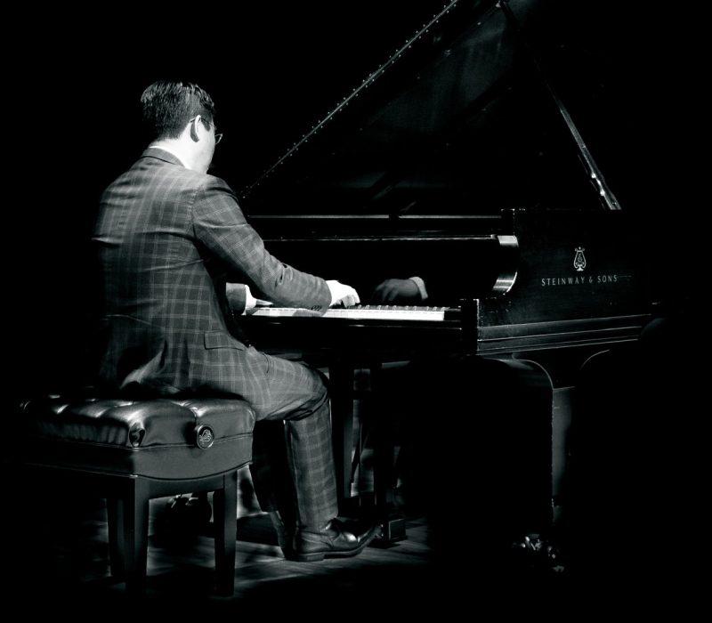 Chih-Long Hu playing piano