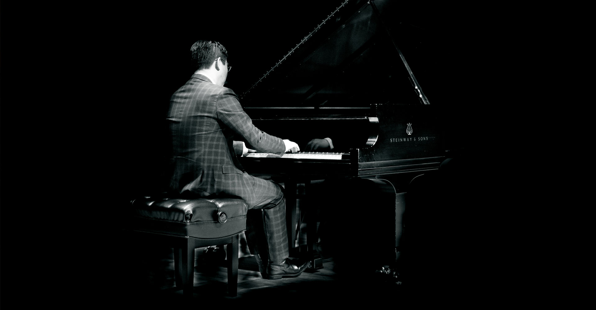 Chih-Long Hu playing piano