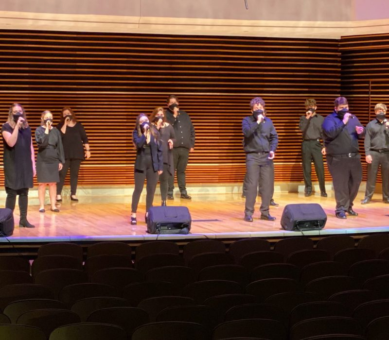 The UT Singers perform in the Sandra G. Powell Recital Hall while wearing masks and being proprerly socially distanced.